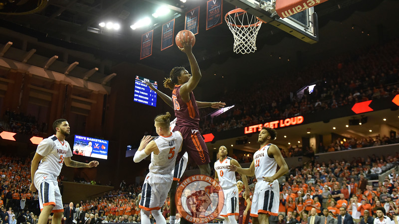 Virginia Tech Hokies guard/forward Chris Clarke (15) rises to the rim over Virginia Cavaliers guard Kyle Guy (5). (Michael Shroyer/ TheKeyPlay.com)