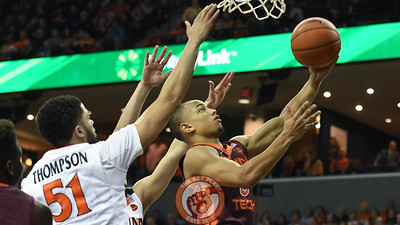 Virginia Tech Hokies guard Justin Robinson (5) attempts a layup past Virginia Cavaliers guard Darius Thompson (51). (Michael Shroyer/ TheKeyPlay.com)
