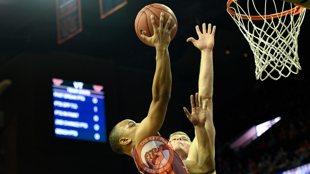 Virginia Tech Hokies guard Justin Robinson (5) attempts a shot over Virginia Cavaliers center Jack Salt (33). (Michael Shroyer/ TheKeyPlay.com)