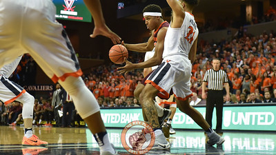 Virginia Tech Hokies forward Zach LeDay (32) drives to the basket while being defended by Virginia Cavaliers forward Isaiah Wilkins (21). (Michael Shroyer/ TheKeyPlay.com)