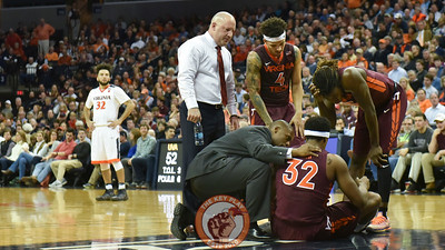 Virginia Tech Hokies forward Zach LeDay (32) is examined after being injured in the second half. (Michael Shroyer/ TheKeyPlay.com)