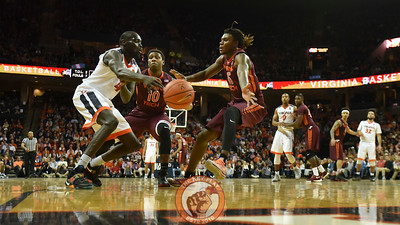Virginia Cavaliers guard Marial Shayok (4) passes out of the full court press while being defended by Virginia Tech Hokies guard/forward Chris Clarke (15) and guard Justin Bibbs (10)(Michael Shroyer/ TheKeyPlay.com)