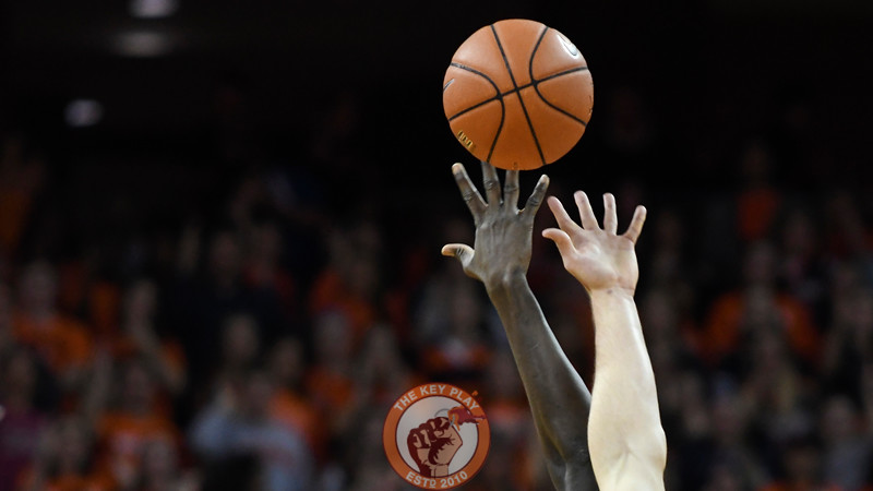 Virginia Tech Hokies forward Khadim Sy (2) battles for the opening tip. (Michael Shroyer/ TheKeyPlay.com)