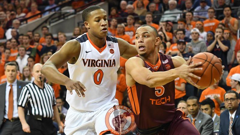 Virginia Tech Hokies guard Justin Robinson (5) drives to the basket past Virginia Cavaliers guard Devon Hall (0).(Michael Shroyer/ TheKeyPlay.com)