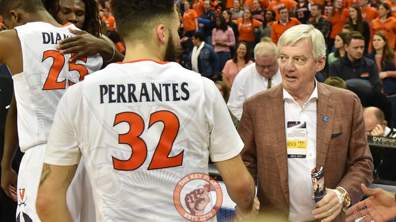 Former Virginia Tech head football coach Frank Beamer shakes hands with Virginia Cavaliers guard London Perrantes (32) following the game. (Michael Shroyer/ TheKeyPlay.com)