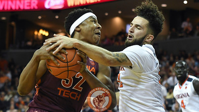 Virginia Tech Hokies forward Zach LeDay (32) has his shot attempt blocked by Virginia Cavaliers guard London Perrantes (32). (Michael Shroyer/ TheKeyPlay.com)