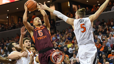 Virginia Tech Hokies guard Justin Robinson (5) looks for space to shoot while being defended by Virginia Cavaliers guard Kyle Guy (5). (Michael Shroyer/ TheKeyPlay.com)