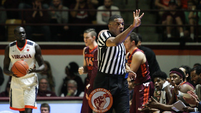 Referee Teddy Valentine signals after a foul is called on UVa. (Mark Umansky/TheKeyPlay.com)