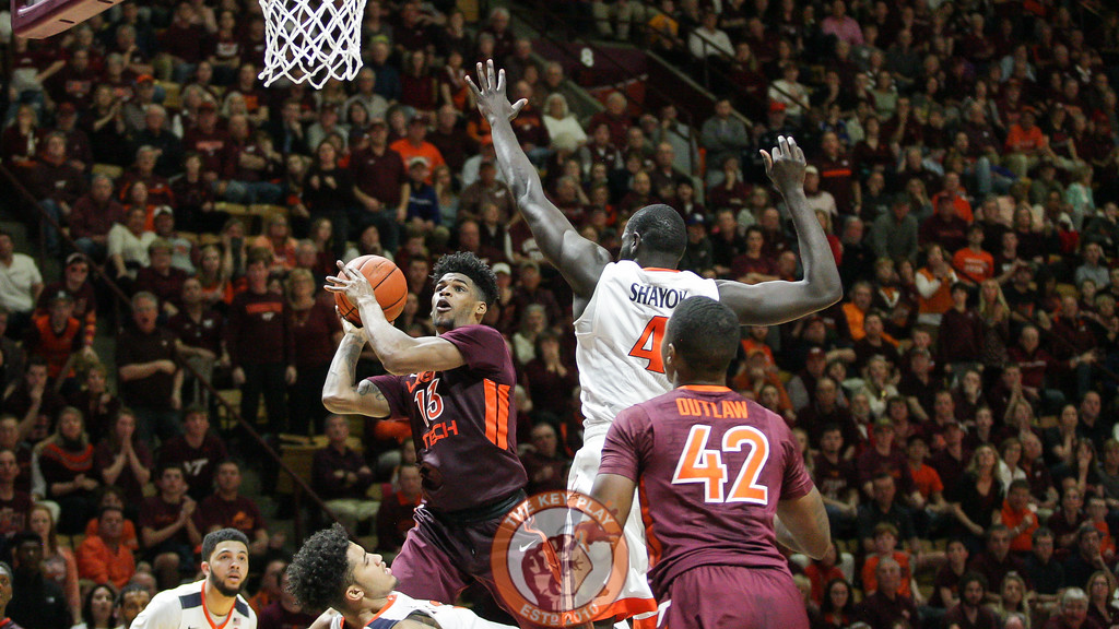 Ahmed Hill flies towards the basket with a pair of UVa defenders right on him. (Mark Umansky/TheKeyPlay.com)