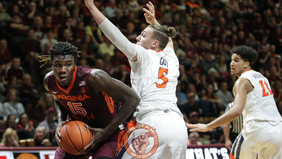 Chris Clarke manuevers around UVa's Kyle Guy. (Mark Umansky/TheKeyPlay.com)