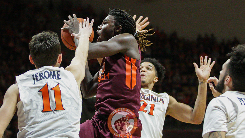 Chris Clarke leaps up for a layup while covered by several UVa defenders. (Mark Umansky/TheKeyPlay.com)