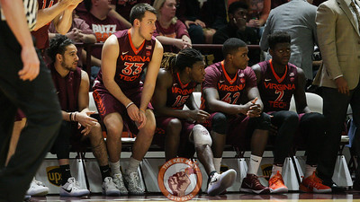 Chris Clarke rejoins the Virginia Tech bench with an ice pack wrapped around his injured knee. He would not return for the remainder of the game. (Mark Umansky/TheKeyPlay.com)