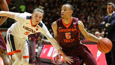 Justin Robinson dribble past Kyle Guy in the first half. (Mark Umansky/TheKeyPlay.com)