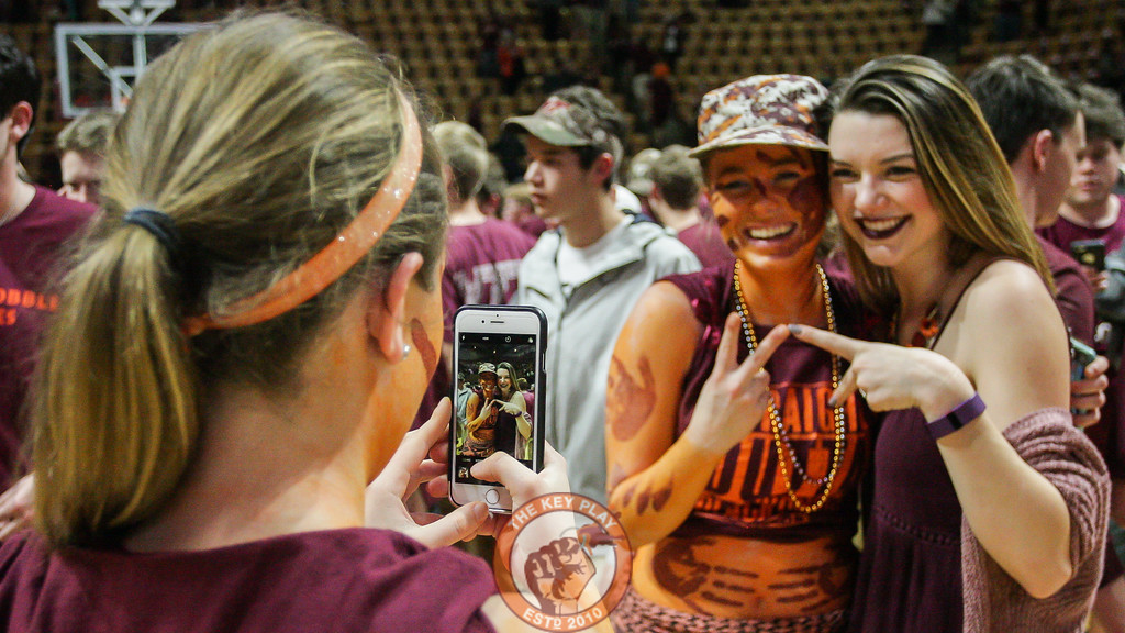Students pose for pictures after rushing the court following the Hokies win. (Mark Umansky/TheKeyPlay.com)