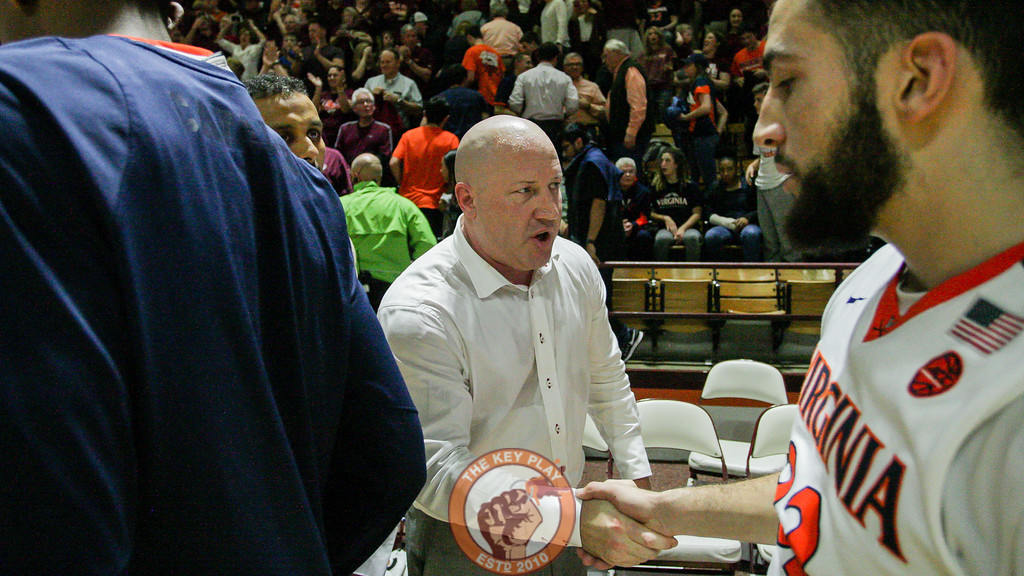 Buzz Williams shakes hands with London Perrantes as the Hokies celebrate on the court. (Mark Umansky/TheKeyPlay.com)