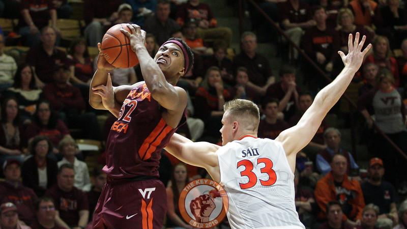 Zach Leday looks for a layup as UVa's Jack Salt fouls him from behind. (Mark Umansky/TheKeyPlay.com)