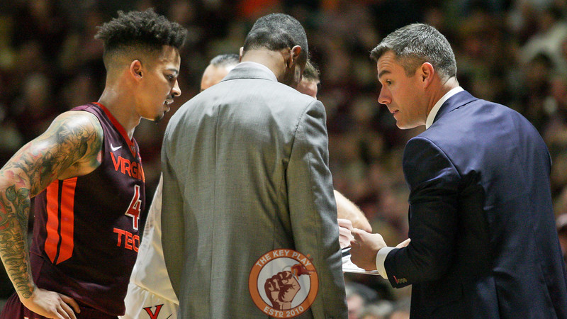 Seth Allen tries to crash an impromptu UVa huddle during a brief pause in the action. (Mark Umansky/TheKeyPlay.com)