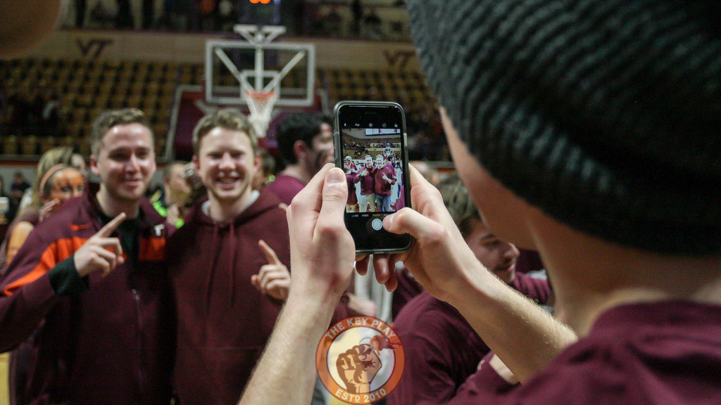Students pose for photos on Cassell's floor as the court rush winds down. (Mark Umansky/TheKeyPlay.com)