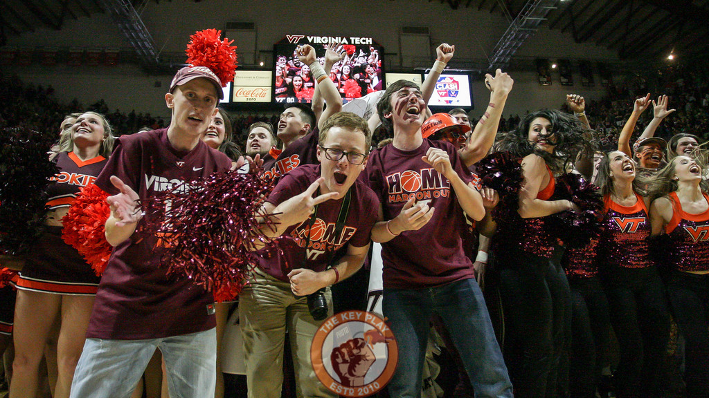 Students celebrate as they rush the court after the win. (Mark Umansky/TheKeyPlay.com)