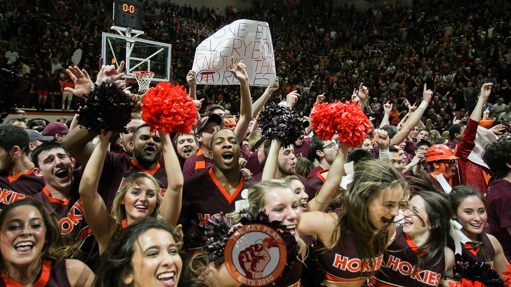 Students start to jump onto the court as the rush begins. (Mark Umansky/TheKeyPlay.com)