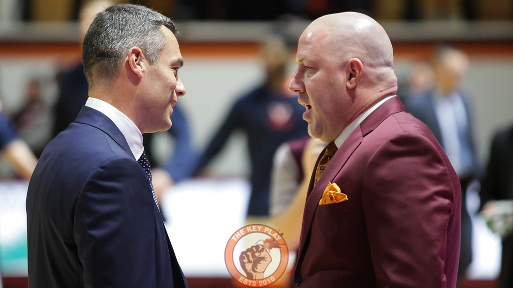 UVa head coach Tony Bennett and Virginia Tech head coach Buzz Williams have a pre-game chat as the teams warm up. (Mark Umansky/TheKeyPlay.com)