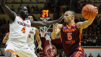 Justin Robinson (5) tries to dribble past UVa's Marial Shayok. (Mark Umansky/TheKeyPlay.com)