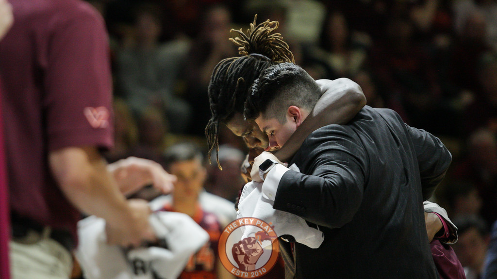 Chris Clarke is helped off the floor and to the locker room after his injury. (Mark Umansky/TheKeyPlay.com)