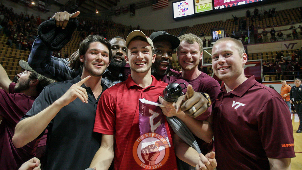 Paul Debnam poses with students on the court after the game. (Mark Umansky/TheKeyPlay.com)