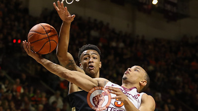 Justin Robinson attempts a layup under heavy defensive pressure by Wake Forest. (Mark Umansky/TheKeyPlay.com)