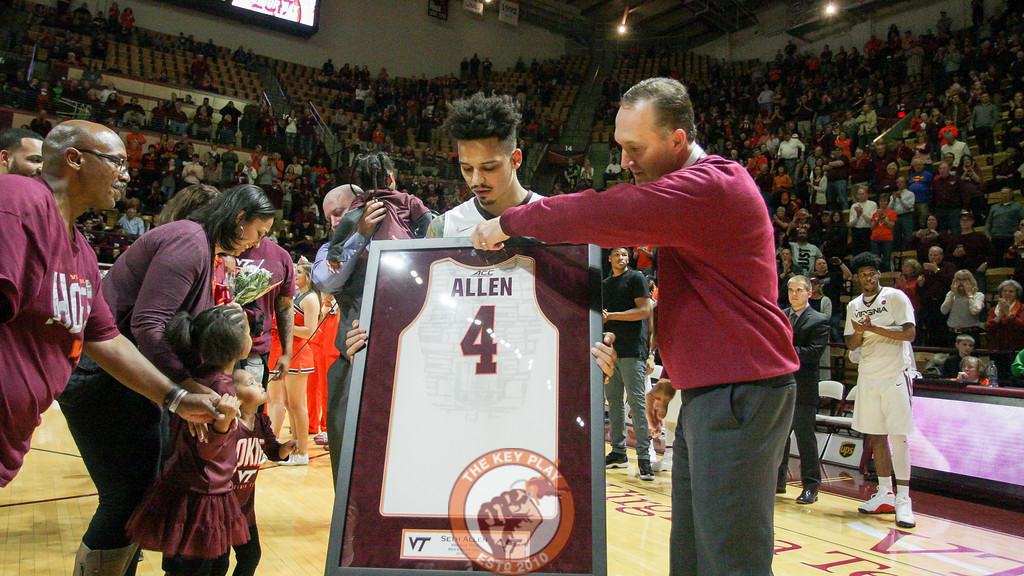 Whit Babcock presents Seth Allen with a framed jersey. (Mark Umansky/TheKeyPlay.com)