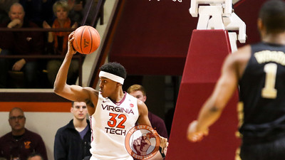 Zach LeDay palms the ball over his head after pulling down an early rebound. (Mark Umansky/TheKeyPlay.com)