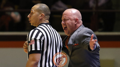 Head coach Buzz Williams shouts at a referee after a call goes against the Hokies. (Mark Umansky/TheKeyPlay.com)
