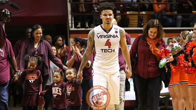 Seth Allen walks out onto the court with his family during Senior Day festivities. (Mark Umansky/TheKeyPlay.com)