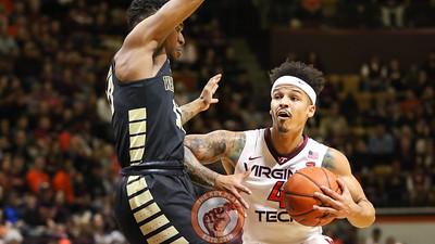 Seth Allen fights for some room as he drives towards the basket. (Mark Umansky/TheKeyPlay.com)