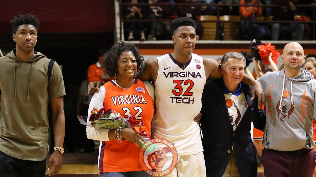 Zach Leday walks out onto the court with his family after the game. (Mark Umansky/TheKeyPlay.com)