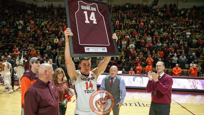 Greg Donlon holds up a framed jersey with his name and number on it during Senior Day festivities after the game. (Mark Umansky/TheKeyPlay.com)