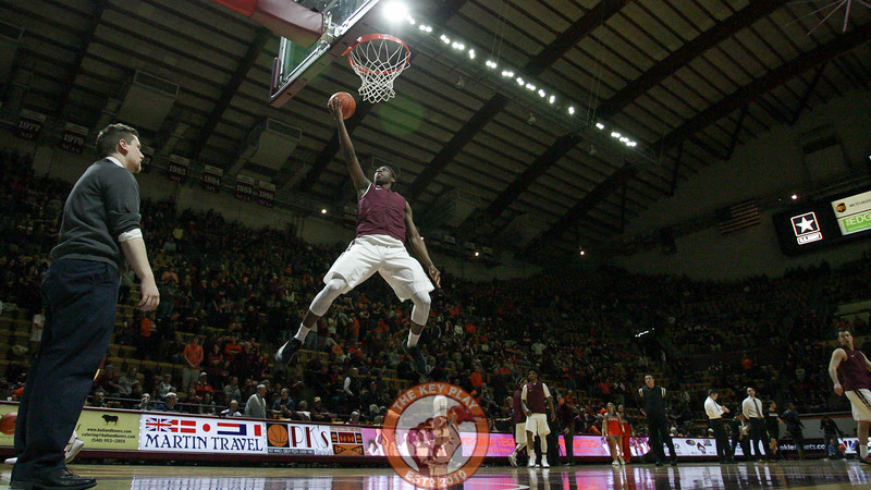 Justin Bibbs leaps up for a layup during warmups before the game. (Mark Umansky/TheKeyPlay.com)