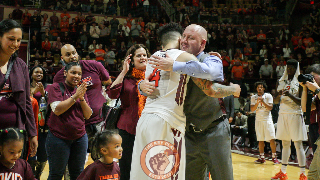 Seth Allen and Buzz Williams share a hug on the court as he's honored during Senior Day. (Mark Umansky/TheKeyPlay.com)