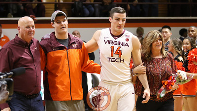 Greg Donlon walks out onto the court with his family during Senior Day festivities after the game. (Mark Umansky/TheKeyPlay.com)