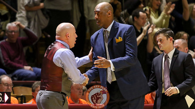 Buzz Williams shakes hands with Wake Forest head coach Danny Manning after the final whistle. The Hokies lost 89-84. (Mark Umansky/TheKeyPlay.com)