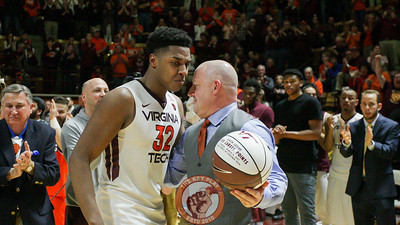 Head coach Buzz Williams presents Zach LeDay with a ball marking his 1000th career point scored during the game. (Mark Umansky/TheKeyPlay.com)