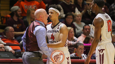 Seth Allen (4) gets in front of head coach Buzz Williams as he shouts at the referees after a foul was called against the Hokies near the final whistle. (Mark Umansky/TheKeyPlay.com)