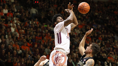 Ahmed Hill gets the ball knocked out of his hands as he attempts a layup. (Mark Umansky/TheKeyPlay.com)