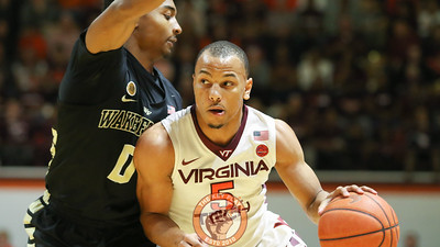 Justin Robinson fights off a Wake Forest defender as he dribbles towards the basket. (Mark Umansky/TheKeyPlay.com)