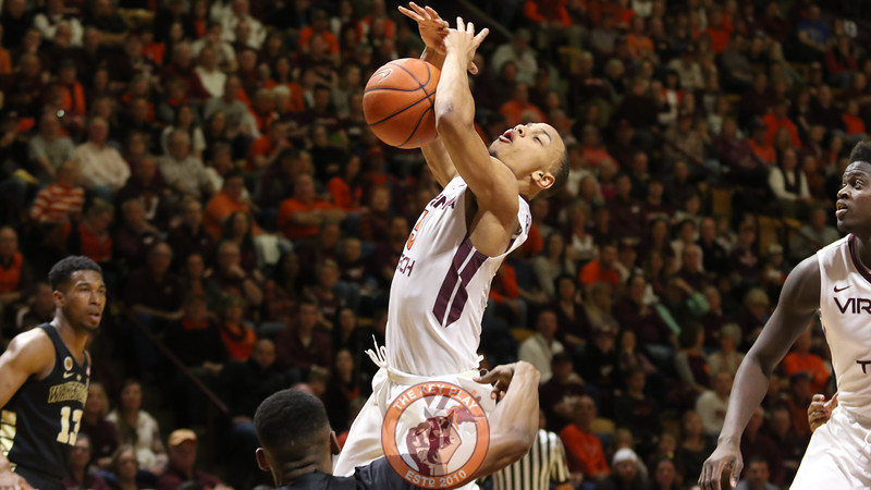 Justin Robinson has the ball knocked away from him on a layup attempt. (Mark Umansky/TheKeyPlay.com)