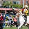 The 16th Annual Fitchburg Blacksmith Art and Renaissance Festival was held Saturday, Sept. 29, 2019 at Riverfront Park in Fitchburg. Krystianna Lett of New Salem with the Iron Clad Jousting show her skills with a sward by cutting a head of lettuce as she road by on her horse during her performance at the festival. SENTINEL & ENTERPRISE/JOHN LOVE