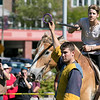 The 16th Annual Fitchburg Blacksmith Art and Renaissance Festival was held Saturday, Sept. 29, 2019 at Riverfront Park in Fitchburg. Cristian Lett of New Salem with the Iron Clad Jousting playing Sr. Cristoffe Von Stuben holds a ring for Squire Hans Lett so he could show off his skills with a joust during their performance at the festival. SENTINEL & ENTERPRISE/JOHN LOVE