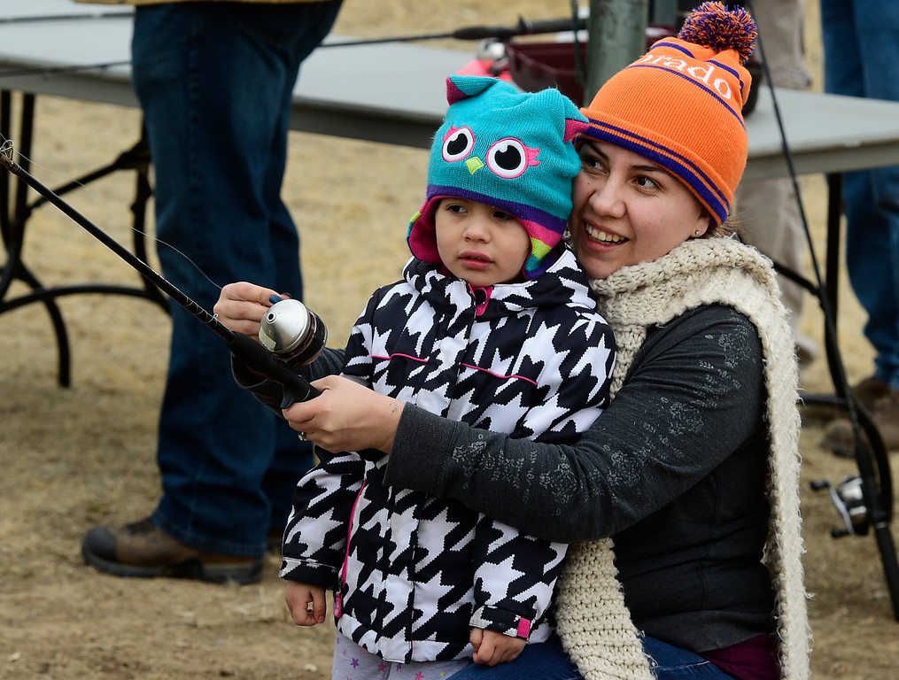 . Longmont, CO - March 23, 2019:  Crystal Prieto, right, shows Valerie Castillo, 3, how to cast a rod during the 16th annual Chick Clark Kids� Fishing Program at Izaak Walton Pond in Longmont. For more photos, go to Timescall.com. (Photo by Cliff Grassmick/Staff Photographer)