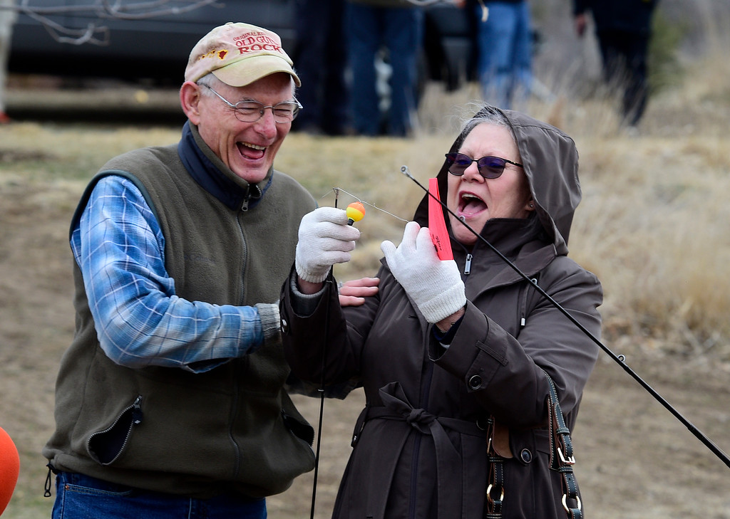 . Longmont, CO - March 23, 2019:  Michael Hall, left, helps Anne Shelton get untangled during the 16th annual Chick Clark Kids� Fishing Program at Izaak Walton Pond in Longmont. For more photos, go to Timescall.com. (Photo by Cliff Grassmick/Staff Photographer)