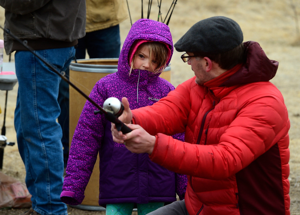 . Longmont, CO - March 23, 2019:   Kaleigh Overby, 5, listens to her dad, Jonathan, explain the casting process during the 16th annual Chick Clark Kids� Fishing Program at Izaak Walton Pond in Longmont. For more photos, go to Timescall.com. (Photo by Cliff Grassmick/Staff Photographer)